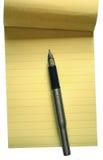 Las paginaciones de la pluma y de la nota Fotos de archivo libres de regalías