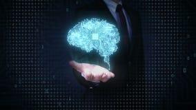 Las palmas abiertas del hombre de negocios, microprocesador de la CPU del cerebro, crecen la inteligencia artificial almacen de video