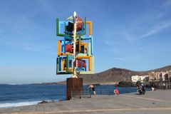 Las Palmas. SPAIN - NOVEMBER 30, 2015: People visit Wind sculpture in , Gran Canaria, Spain. The modern art piece was made by Cesar Manrique and stands at stock photography