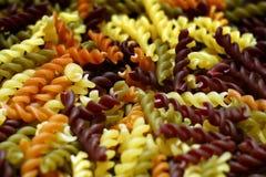 Las pastas frescas giran multicolor Fotos de archivo
