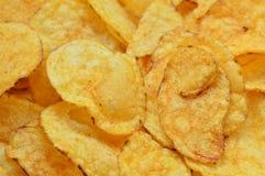 Las patatas fritas curruscantes se cierran para arriba Fotografía de archivo
