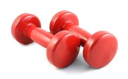 Las pesas de gimnasia rojas se cierran para arriba foto de archivo