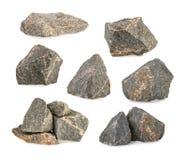 Las piedras del granito, rocas fijaron aislado en el fondo blanco imagenes de archivo