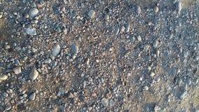 Las piedras hermosas del smoll en la playa foto de archivo libre de regalías