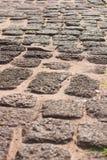 Las piedras viejas del arreglo son calzada Foto de archivo libre de regalías