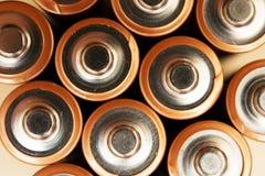 Las pilas AA rematan Clocseup Imagen de archivo libre de regalías