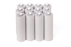 Las pilas AA se colocan en fila Foto de archivo libre de regalías