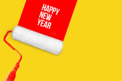 Las pinturas blancas del rodillo en la pared congriegan Feliz Año Nuevo Fotos de archivo libres de regalías