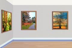 Las pinturas del arte que representan la naturaleza del otoño cuelgan en la pared foto de archivo libre de regalías