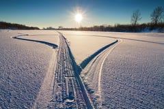 Las pistas de la moto de nieve Fotografía de archivo libre de regalías