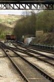 Las pistas ferroviarias del hierro que convergen en North Yorkshire amarran el carril Imágenes de archivo libres de regalías