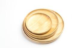Las placas o las bandejas de madera aislaron el fondo blanco Fotos de archivo libres de regalías