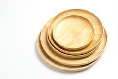 Las placas o las bandejas de madera aislaron el fondo blanco Imagenes de archivo