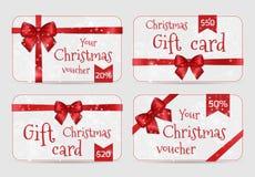 Las plantillas ornamentales de la tarjeta de la Navidad con la cinta roja del día de fiesta brillante arquean Imagenes de archivo