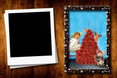 Las postales de la Navidad vacian el marco de la foto Fotografía de archivo