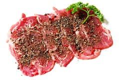 Las rebanadas de la carne de vaca aislaron Imagen de archivo