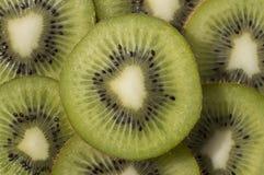 Las rebanadas del kiwi imagenes de archivo