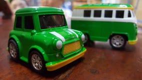 Las ruedas en los coches verdes Imágenes de archivo libres de regalías