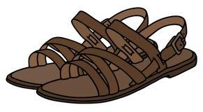 Las sandalias de la mujer de cuero Imagenes de archivo