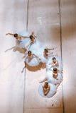 Las siete bailarinas en piso Imagenes de archivo