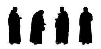 Las siluetas cristianas de los monjes fijaron 1 Imagenes de archivo