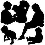 Las siluetas de los niños Fotografía de archivo libre de regalías