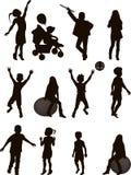Siluetas de niños Foto de archivo libre de regalías