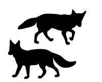 Las siluetas negras de dos zorros Imágenes de archivo libres de regalías