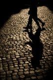 Las sombras proyectaron en la calle Imágenes de archivo libres de regalías