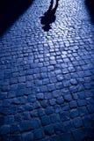 Las sombras proyectaron en la calle Fotos de archivo libres de regalías