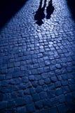 Las sombras proyectaron en la calle Foto de archivo