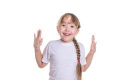 Las sonrisas de la muchacha que aumentan las manos para arriba Imagen de archivo