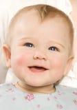 Las sonrisas del bebé Imagen de archivo libre de regalías