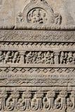 Las tallas de la roca texturizan el fondo de la cueva de Ajanta en Aurangabad, la India imagen de archivo libre de regalías