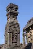 Las tallas de la roca texturizan el fondo de Ellora Caves en Aurangabad, la India Un sitio del patrimonio mundial de la UNESCO en Foto de archivo libre de regalías