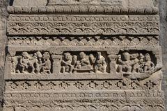 Las tallas de la roca texturizan el fondo de Ellora Caves en Aurangabad, la India Un sitio del patrimonio mundial de la UNESCO en Imagen de archivo