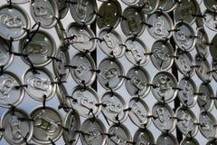 Las tapas en las latas Imagenes de archivo