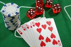 Las tarjetas del póker, saltan y cortan en cuadritos Foto de archivo libre de regalías