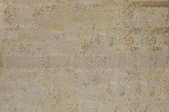 Las texturas del yeso, debajo del cual está un ladrillo Gris y marrón texturizada fondo fotos de archivo