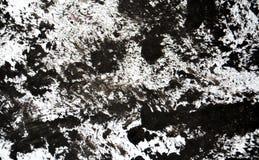 Las tonalidades fangosas grises negras blancas, puntos ponen en contraste el fondo de pintura de la acuarela, acrílico de la acua foto de archivo