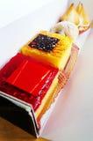 Las tortas gastrónomas del postre se llevan Imagen de archivo libre de regalías