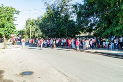 LAS TUNAS, CUBA - JAN 28, 2016: People prepare for a parade celebrating the birthday of Jose Marti, Cuban national hero royalty free stock photo