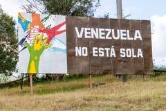LAS TUNAS, CUBA - JAN 27, 2016: Propaganda billboard at Plaza de la Revolucion Square of the Revolution in Las Tunas. It says: Venezula is not alone stock image