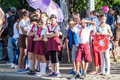 LAS TUNAS, CUBA - JAN 28, 2016: Young Pioneers prepare for a parade celebrating the birthday of Jose Marti, Cuban royalty free stock images