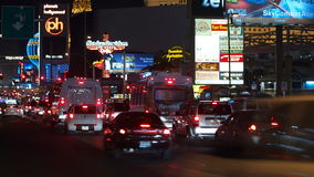 Las Vegas Bl Night Traffic Time Lapse. Editorial time lapse clip of heavy night traffic at Planet Hollywood, Balleys and other resorts on the Las Vegas strip stock video footage