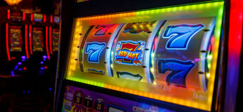 777 WINS by Las Vegas casino. Las Vegas night, long awaited by tourists from around the world. Luck present winning numbers. Casino Las Vegas Nevada stock photography