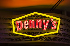 Las Vegas - Circa July 2017: Neon Logo and signage of a Denny`s Coffee Shop. Denny`s is America`s Diner VI Stock Photography