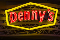 Las Vegas - Circa July 2017: Neon Logo and signage of a Denny's Coffee Shop. Denny's is America's Diner VII Royalty Free Stock Photo