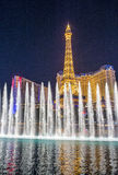 Las Vegas , fountains. LAS VEGAS - OCT 05 : Night view of the dancing fountains of Bellagio and the Eiffel Tower replica of Paris hotel in Las Vegas Nevada, on stock image