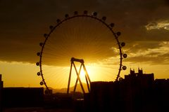 The High Roller Wheel light up at as sunrise comes through the w Royalty Free Stock Photos